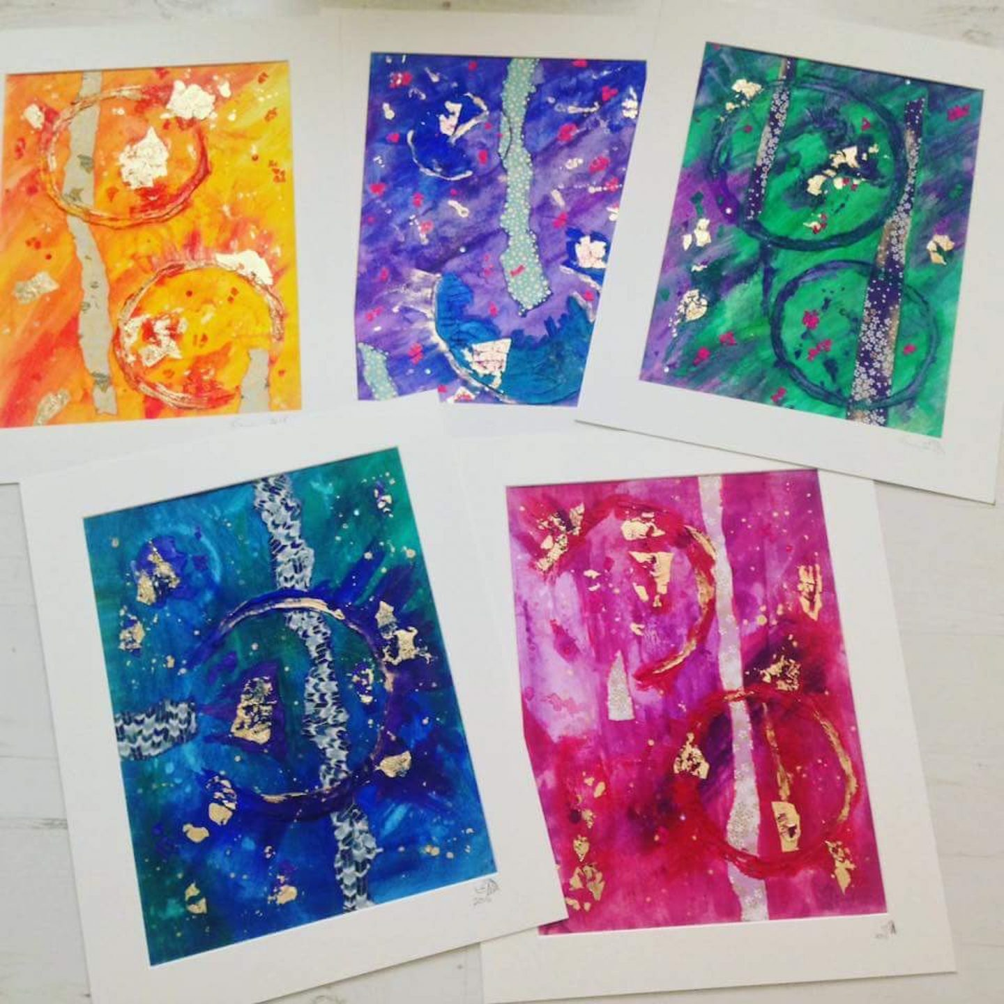 Colourful and textured abstract art pieces on paper.
